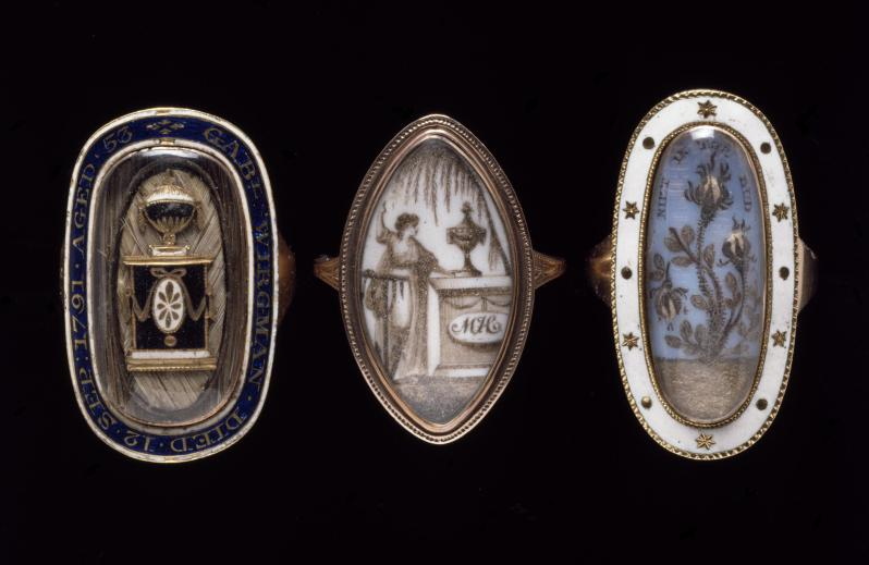 Mourning Ring. Enamelled gold and woven hair under a rock crystal pane. 1791. Courtesy of the Victoria and Albert Museum. The inscription around the enamelled edge of this mourning ring tells us that it was made to commemorate Gabriel Wirgman, who died on 12 September 1791 aged 53.
