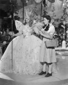 Billie Burke and Judy Garland in The Wizard of Oz (1939). Courtesy of Wikimedia Commons.