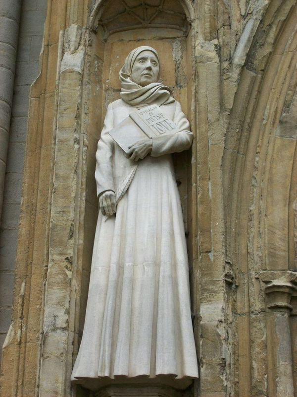 Statue of Julian on the front of Norwich Cathedral, holding the book Revelations of Divine Love. Image courtesy of Wikimedia Commons.