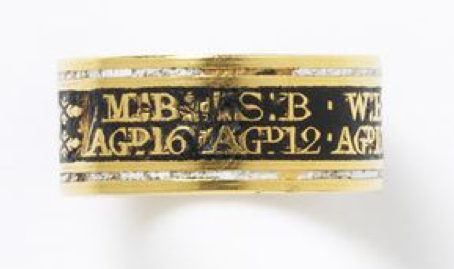 Gold mourning ring enamelled in black with white border. Inscribed in reserve on front enamel in gold lettering,