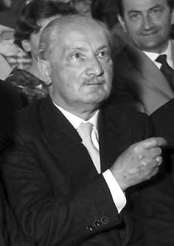 """Photograph of Martin Heidegger. Detail of a phototograph entitled : """"W 134 Nr. 060678b - Hausen: Festakt, in der Reihe, Kultusminister Storz, Prof. Heidegger, Dichtel"""